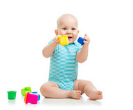 Funny little child is playing with toys over white Royalty Free Stock Photo