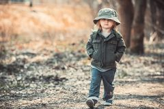 Funny little child walking in the woods Royalty Free Stock Images
