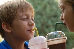 Funny little children drink milkshake Royalty Free Stock Photo