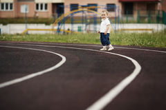 Funny children playing on stadium Stock Photography