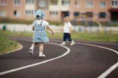 Funny children playing on stadium Stock Photos