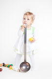 Funny little cook. Little baby girl in the cook costume standing Stock Image