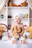 Funny little cook. In kitchen with bakery Stock Images