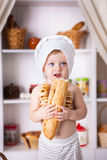 Funny little cook. In kitchen with bakery Royalty Free Stock Photos