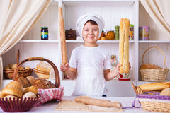 Funny little cook. In kitchen with bakery Stock Photos