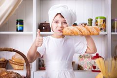 Funny little cook. In kitchen with bakery Royalty Free Stock Photo