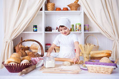 Funny little cook. In kitchen with bakery Royalty Free Stock Images