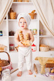 Funny little cook. On kitchen with bakery Stock Images