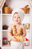 Funny little cook. On kitchen with bakery Stock Photos