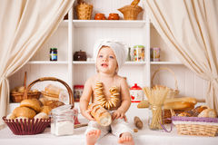 Funny little cook. On kitchen with bakery Royalty Free Stock Photo