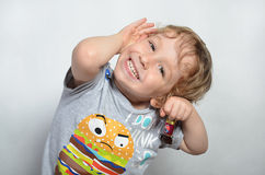 Funny little curly-haired boy 2 Stock Images