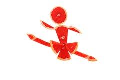 Funny little danser made of the grapefruit slice Stock Image