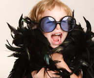 Funny little fashionista. In glasses stock images