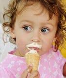 Funny little girl. Cute little girl eating ice cream Royalty Free Stock Photo