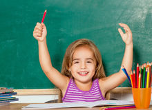Funny little girl. Little girl with pen in hand Royalty Free Stock Photo