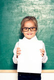 Funny little girl. Little girl with a white sheet in hand Stock Photos