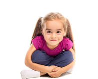 Funny little girl. Cheerful little girl looking at the camera on a white background Stock Image