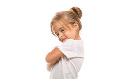Funny little girl. Little girl standing with folded hands on white background Stock Images