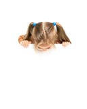 Funny little girl. Little girl looking down on white poster Royalty Free Stock Photos