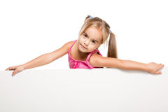 Funny little girl. Happy little girl with white board Stock Photography