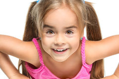 Funny little girl. Little girl cheerfully smiling on a white background Royalty Free Stock Photos