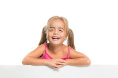 Funny little girl. Little girl cheerfully smiling on a white background Royalty Free Stock Photography