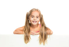 Funny little girl. Little girl cheerfully smiling on a white background Royalty Free Stock Photo