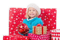Funny little girl around christmas boxes Royalty Free Stock Image
