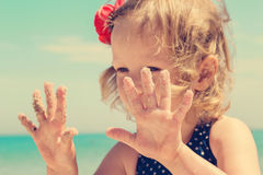 Funny little girl  on the beach. Stock Image