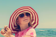 Funny little girl  on the beach. Royalty Free Stock Photos