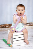Funny little girl with big crayons Royalty Free Stock Image