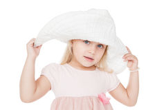 Funny little girl in big hat Royalty Free Stock Photos