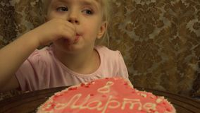 Funny Little Girl Birthday Cake. 4K, UHD, Ultra HD resolution stock footage