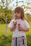 Funny little girl blowing bubble Royalty Free Stock Photo