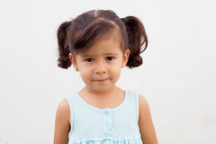 Funny little girl with blue dress outdoor Royalty Free Stock Images