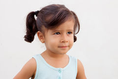 Funny little girl with blue dress outdoor Stock Images