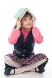 Funny little girl with a book Royalty Free Stock Photo