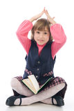 Funny little girl with a book Royalty Free Stock Image