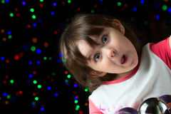 Funny little girl with box of christmas balls Royalty Free Stock Images