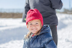 Funny little girl in bright hat smiling Royalty Free Stock Photo