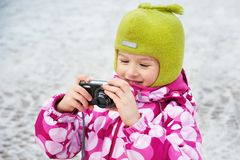 Funny little girl with camera Royalty Free Stock Images