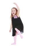 Funny little girl cheerfully waving his arms Stock Photography