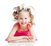 Funny little girl child with pet rat on her head Stock Photo