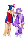 Gossip clowns. Funny little girl clowns whispering and talking gossip Stock Photo