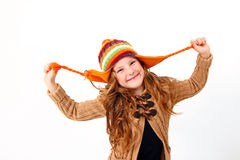Funny little girl in colorful cozy clothing isolated on white ba Royalty Free Stock Image