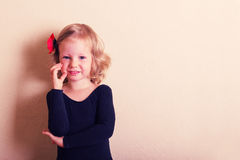 Funny little girl dancing. Stock Photo