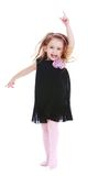 Funny little girl in a dark blue dress waving his Royalty Free Stock Photography