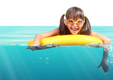 Funny little girl with diving glasses floating inflatable ring, Stock Image