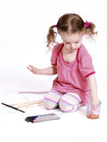 Funny little girl drawing the picture Stock Photos