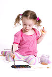 Funny little girl drawing the picture Stock Photo